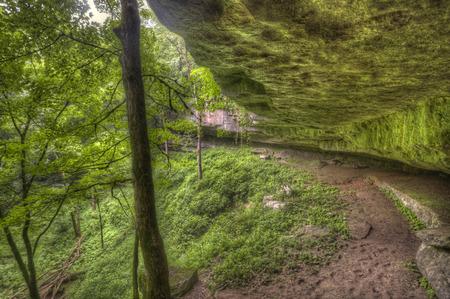 overhang: mossy rock overhang Cedar Sink Trail Mammoth Cave National Park Kentucky Stock Photo