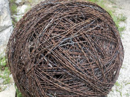 KANSAS: large ball of barbed wire Kansas farm