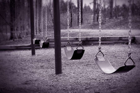 abducted: Some lonely empty swings. Stock Photo