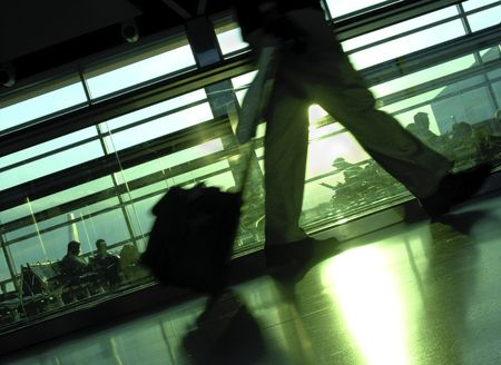 Airport terminal with silhouettes of passengers waiting and in motion. (8MP camera) Stock Photo