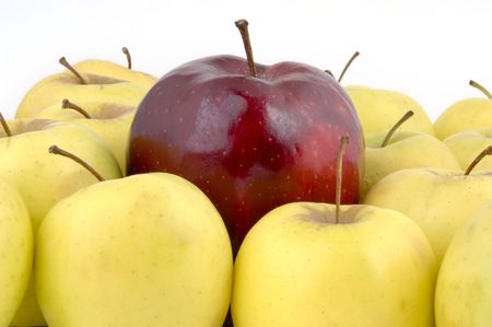 A large red apple surrounded by yellow apples (12MP camera).