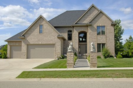 Luxury brick home. Super detail, 12MP camera. Focus is on the lions. Stock Photo
