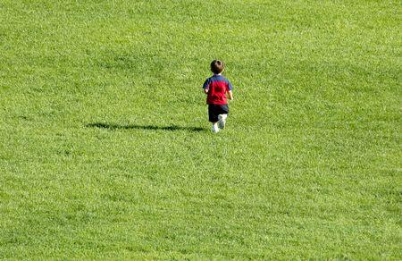 Boy running on grass. 12MP camera.
