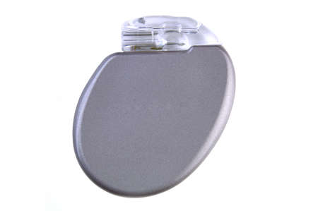 pacemaker: An ICD (Implantable Cardioverter Defibrillator) with pacemaker, 11mm thin, 30cc volume, 2.9 ounces, will be surgically placed in the chest wall.(12MP camera, isolated, macro)