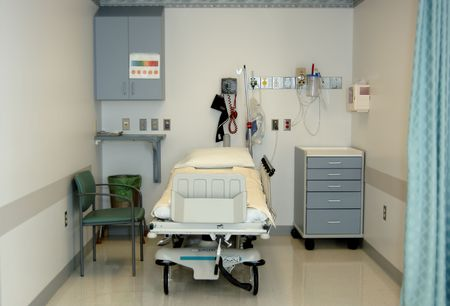 A real hospital bay where patients are prepared before surgery; vitals,paperwork,meds. (12MP camera, Focus=bed) Stock Photo