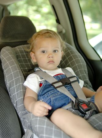 Baby boy in a car seat for safety. Focus = face. (12MP camera, Model Released.)