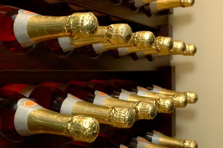Rows of bottled wine in a winery. Focus = 2nd bottles from the left. 12MP camera. Stock Photo
