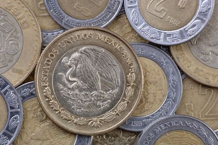 Used Mexican coins, all pesos. Focus = the complete coin, left center. 12MP camera, extreme macro.