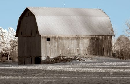 True infrared photo of an aging barn. Focus = barn wall. Modified camera with 720nm cutoff filter. photo