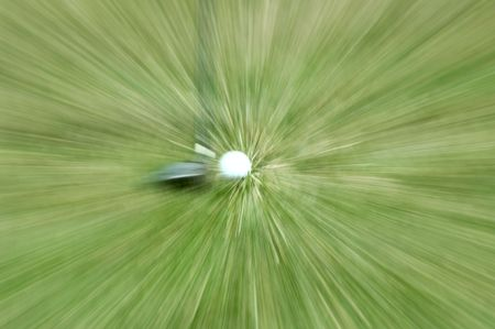 special effect: Real golf club next to a golf ball. Special effect of zoom blur was done in camera, NOT by . 12MP camera.