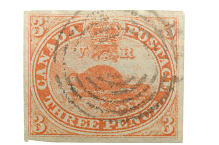 canada stamp: Authentic first stamp of Canada, 1851. 3 Pence Beaver with target cancellation, hand cut.  Stock Photo