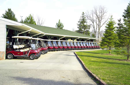A lineup of Golf Carts at Hawk Hollow Golf Course Stock Photo