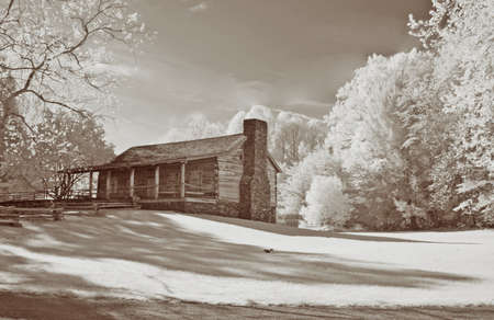 nm: Infrared shot of an old cabin in Cades Cove, TN, Great Smoky Mountains National Park. Modified 6MP camera with 720 nm IR filter to enable faster shutter speed. Stock Photo