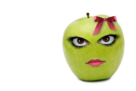 granny smith apple: An apple appears to have the face of a woman.