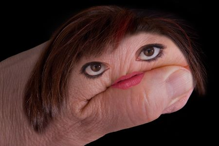 A womans hand has a face, mouth, and hair of a woman.