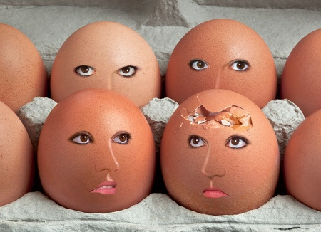 One egg is broken and her friends are concerned. Stock Photo - 15408529