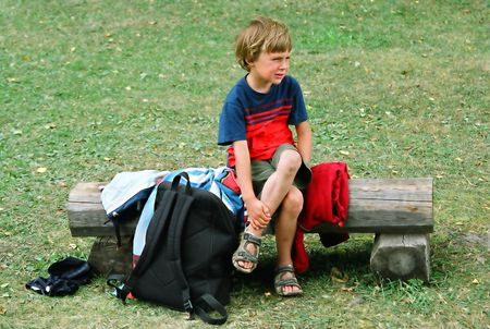 hellion: Boy in pain holding his leg