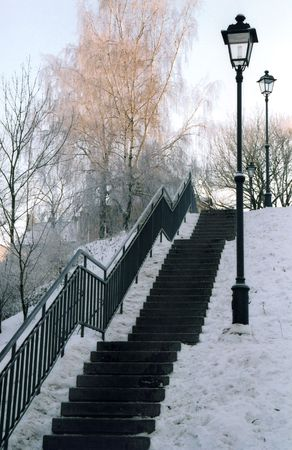 winter scenery: Winter scenery with stairs and street lamps Stock Photo