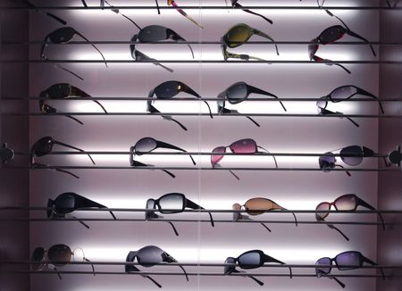 Sunglasses for sale, placed on the shelves, horizontal formation Stock Photo - 631661
