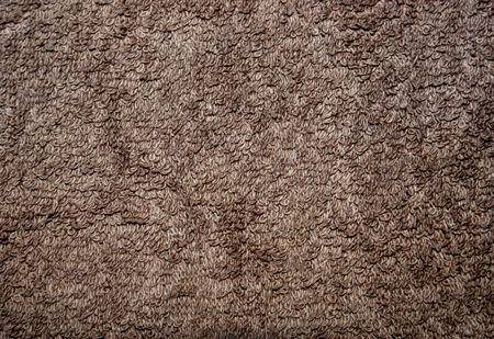 Brown textile background, flat brown terrycloth  towel pattern