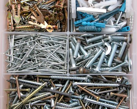 domestic garage: Construction materials, nails and bolts background