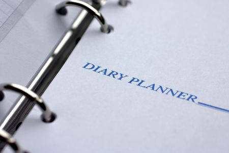 unoccupied: Diary planner closeup, focus on words  Stock Photo