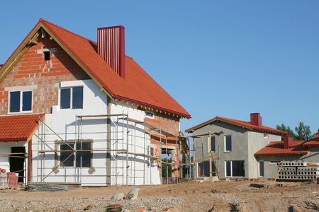stoneworks: Empty new home construction site on clear summer day with blue sky Stock Photo