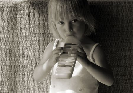 soloist: Little girl playing pipe, black and white photo