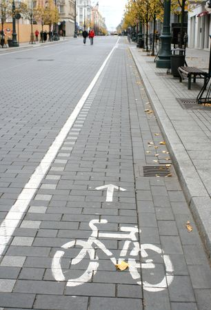 Bicycle route sign on the city road and arrow pointing direction Stock Photo - 1936545