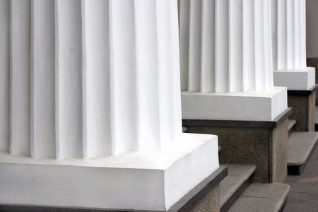 Three classical white greek columns in a row Stock Photo