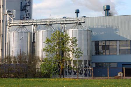 Three shiny steel storage tanks, industrial background