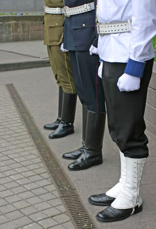 Three soldiers stand guard at lithuanian national flag ceremony photo