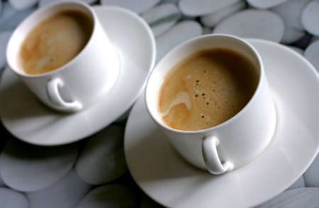 Two coffee cups full of tasty coffee