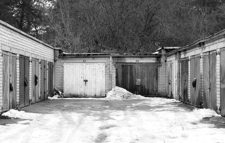 closed community: Image of numerous garage doors on a residential suburb Stock Photo