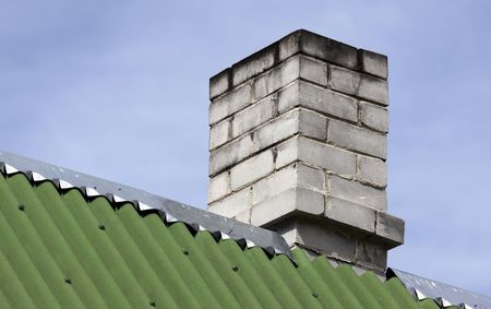 close up chimney: Close up on the building roof and white brick chimney