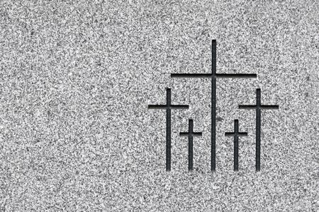 Black and white picture of the group of crosses carved on grey stone. Plenty of space on the left to add text Stock Photo - 5446849