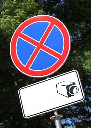 Warning road sign and display board with drawn camera icon. Still plenty of copy space to place text Stock Photo - 5561049