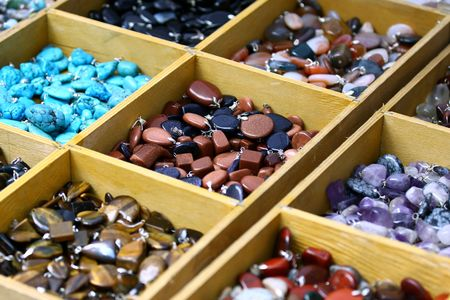 Multicolored trinket stones on sale in different boxes  photo