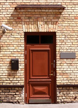 Outside office door with security camera, mailbox and empty signboard to add text Stock Photo - 7563812