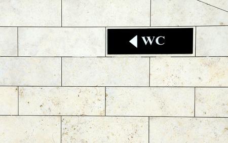 Black toilet sign on the white wall Stock Photo - 9302206