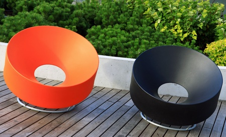 Pair of modern plastic benches at public space photo