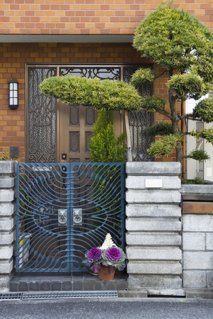 Entrance door with bonsai tree in Japan photo