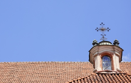 Architectural detail of christian church roof with plenty of copy space on blue sky photo