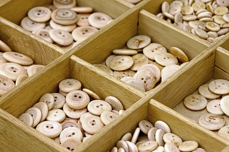 alike: Wooden all alike buttons in wooden box Stock Photo