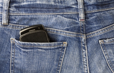 Part of cellphone in the back pocket of blue jeans  photo