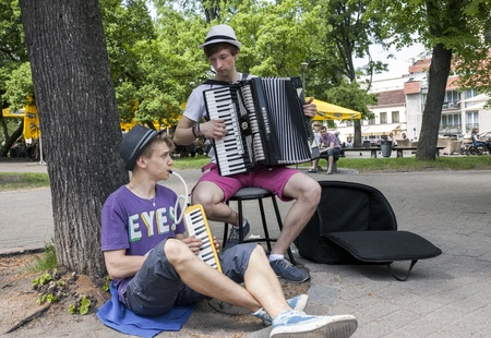 VILNIUS, LITHUANIA - MAY 18, 2013: Performance of street musicians at traditional street musicians festival on May 18, 2013 in Vilnius, Lithuania