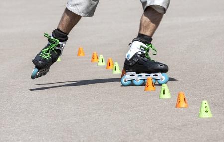 rollerskater: Teenager rollerblading at skate park