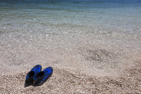 swimming shoes: Pair of swimming shoes on the beach