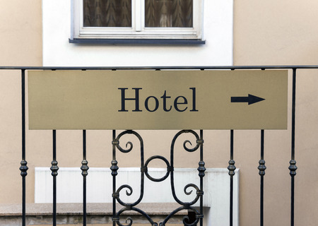 hotel sign: Hotel sign with arrow to show entrance direction Stock Photo