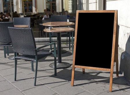blackboards: Empty menu board stand and outdoor cafe